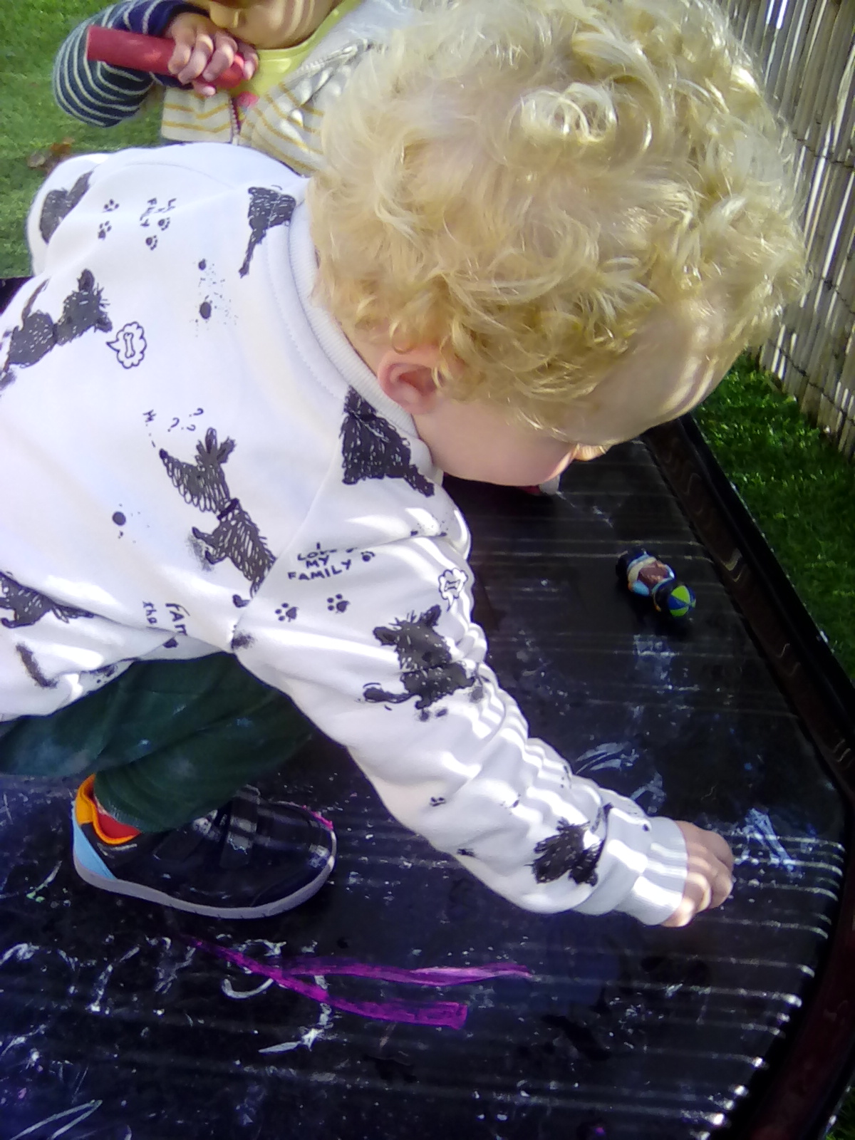 Playing with the chalks outside