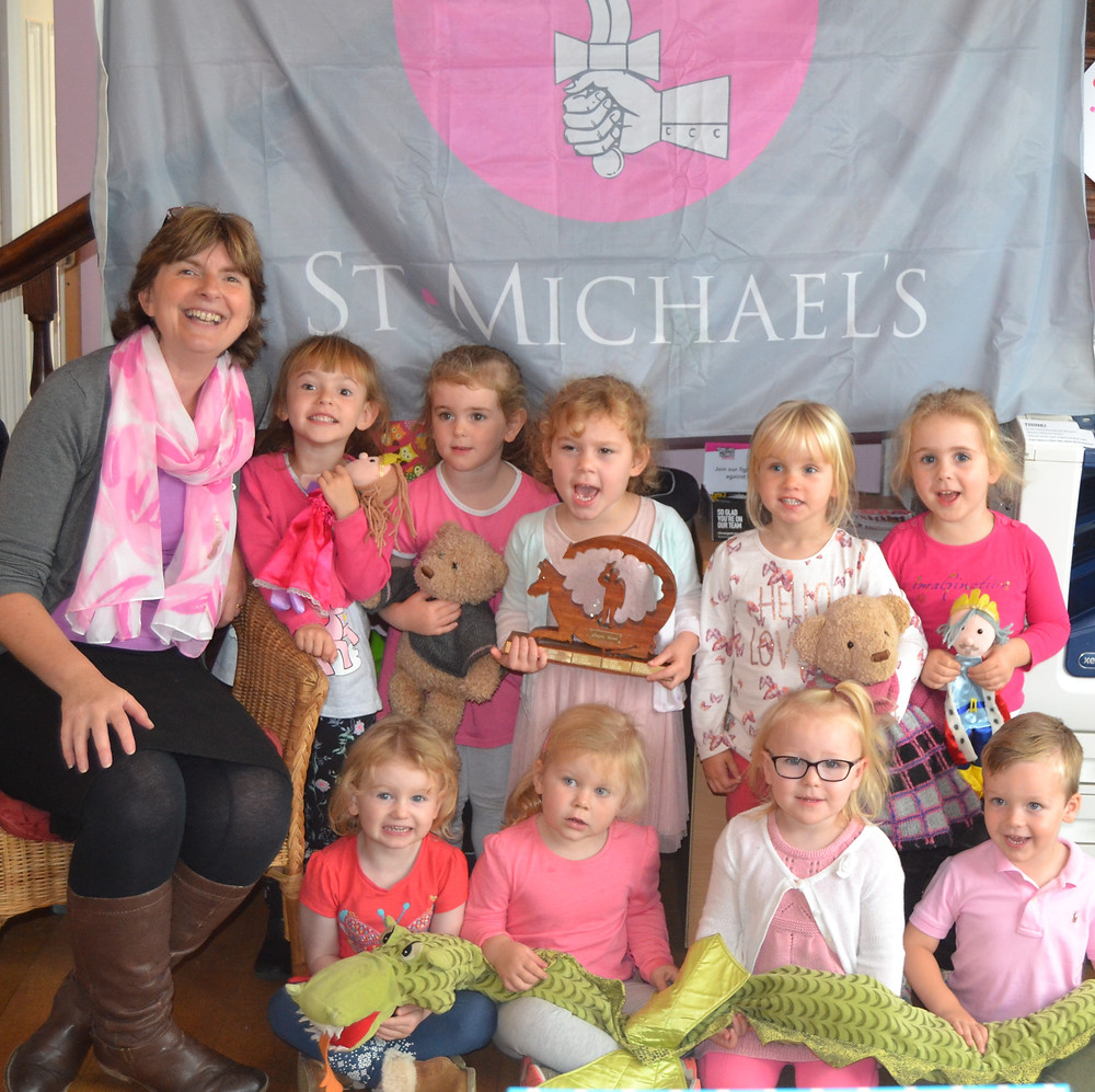 Celebrating St. Michael's Day with a puppet show of our hero Saint Michael, our traditional Pink Wafers for snack and making dragon masks.