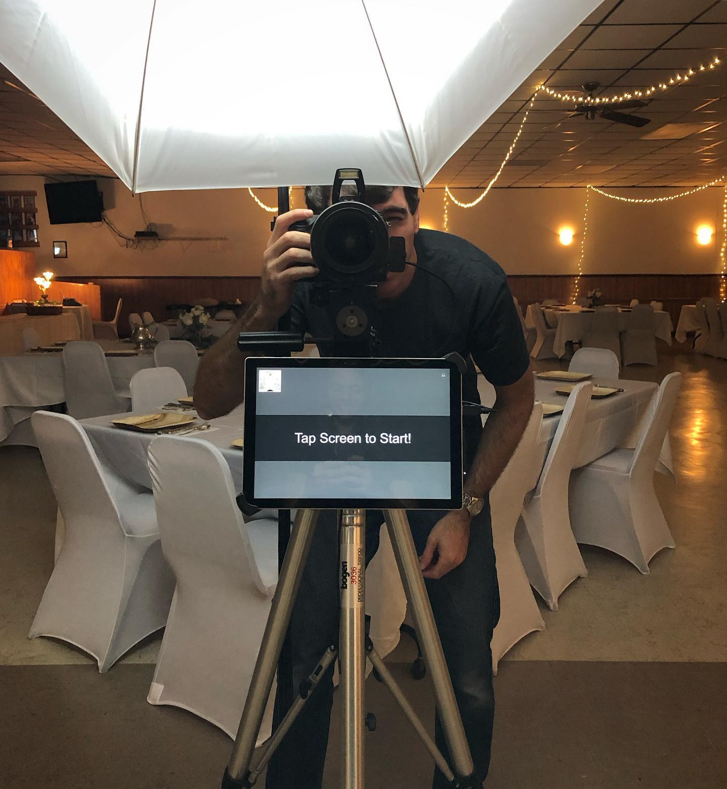 Topher getting the photobooth set up for a private event in Madison, WI