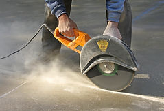 Man cutting control groove in concrete s