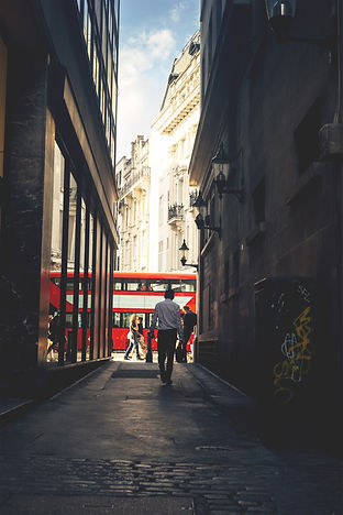 man walking down city