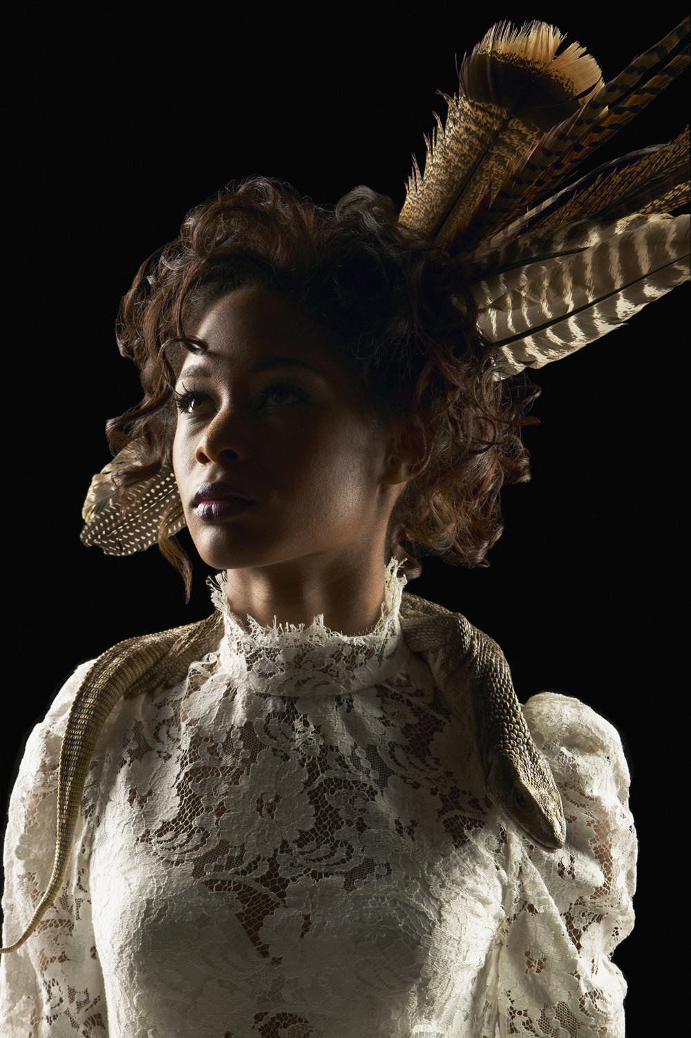 feather head piece with vintage lace dress