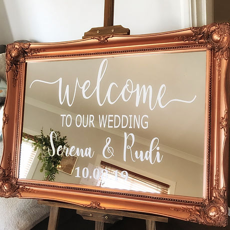 Ornate copper mirror wedding welcome sign