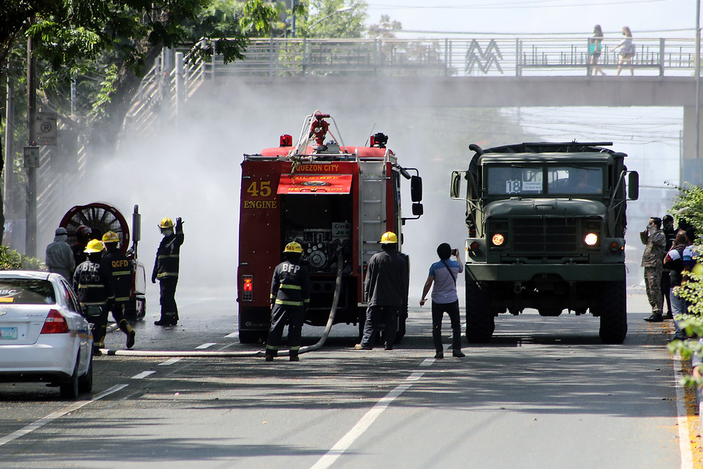 Quezon City passing thru disinfection checkpoints set up by the Bureau of Fire Protection and Quezon City Disaster Risk Reduction and Management Council along East Avenue on Thursday (March 19, 2020). The city government has intensified sanitation measures in line with the Luzon-wide enhanced community quarantine to curb the spread of coronavirus disease 2019 (Covid-19). (PNA photo by Joey O. Razon)