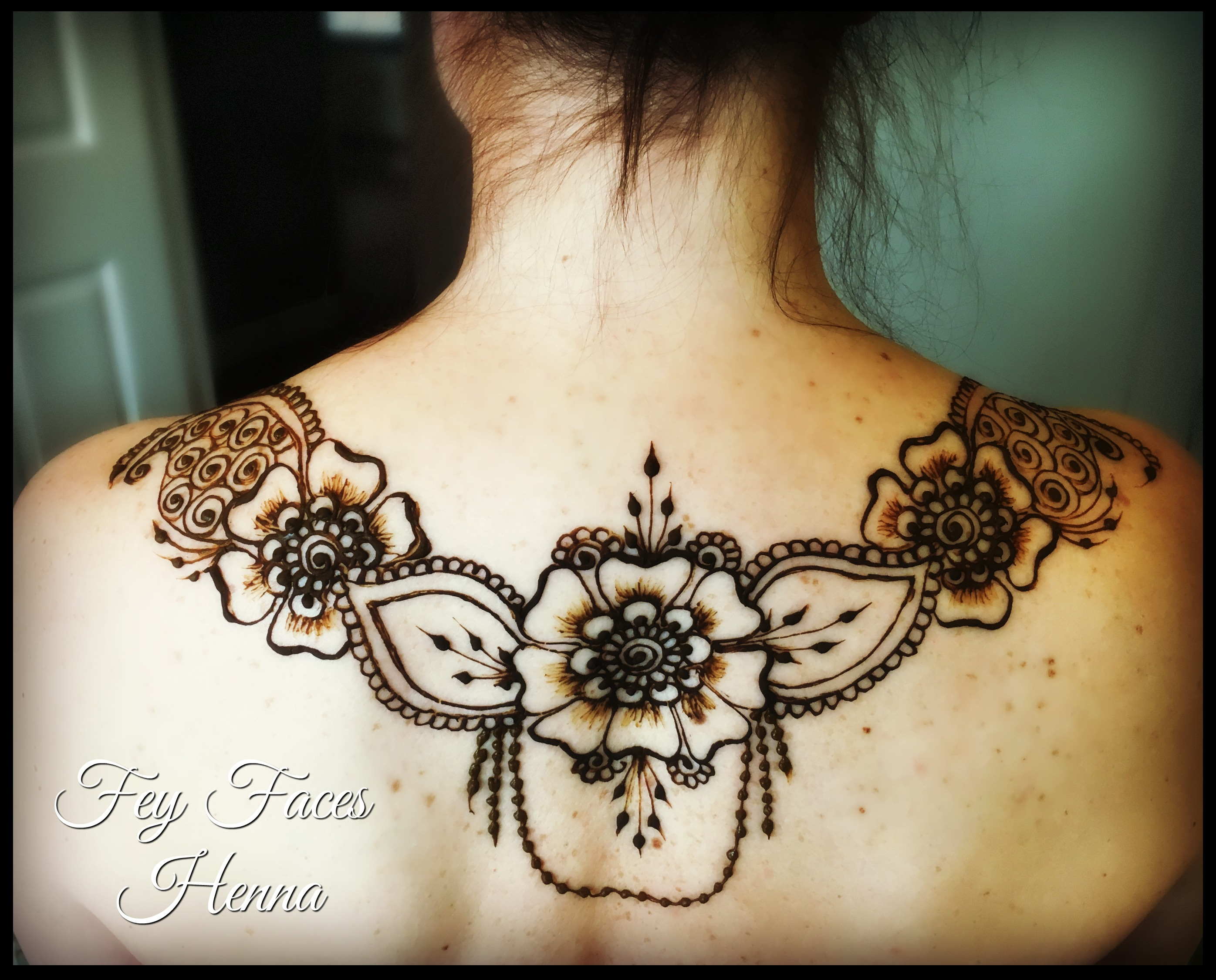Back henna by Fey Faces