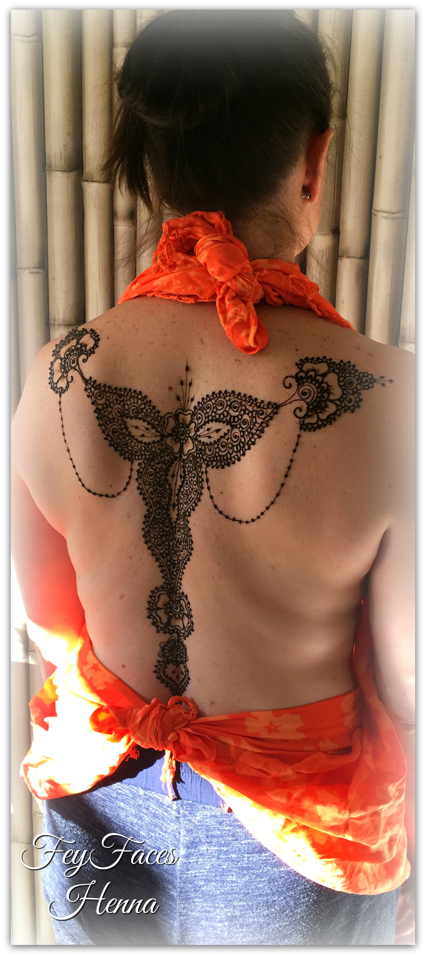 Back henna design by Fey Faces