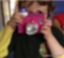 Child and junk model camera.png