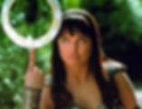 Xena balancing chakram on her finger.