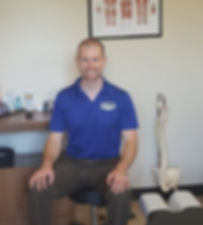 Dr. Andrew Makos in treatment room