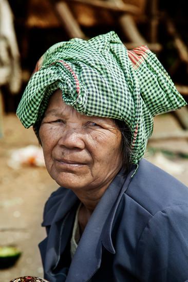 Woman working.Tonle Sap, Cambodia