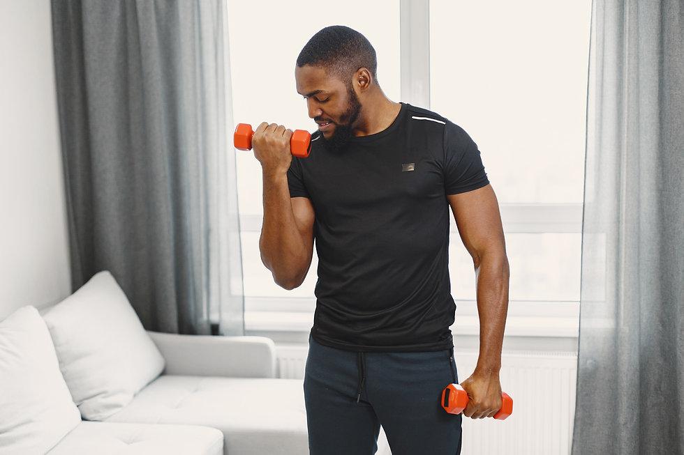 guy-training-home-with-dumbbells.jpg