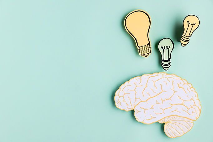 copy-space-paper-brain-with-light-bulb.j