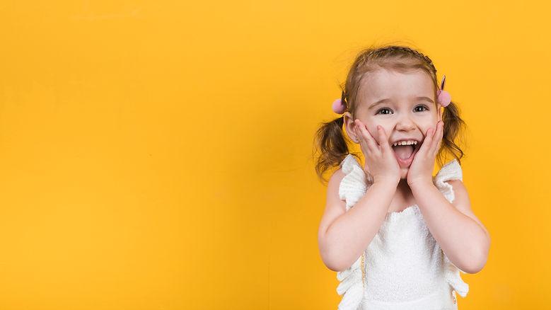 amazed-girl-yellow-background.jpg