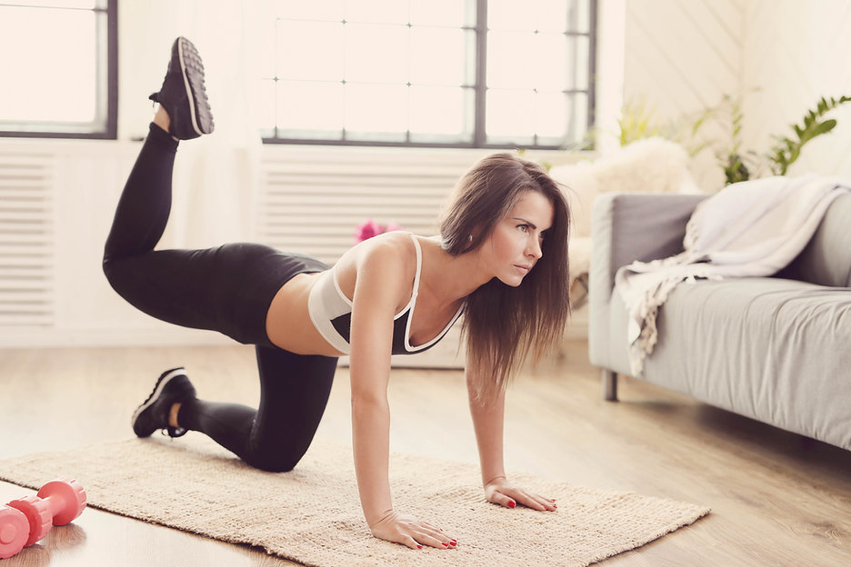 sporty-woman-working-out-home.jpg