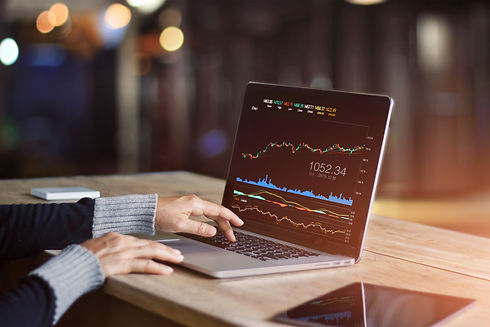 businessman-using-laptop-for-analyzing-data-stock-market--forex-trading-graph--stock-excha