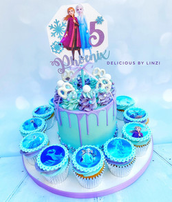 frozen themed drip cake with matching cu