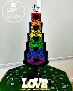 Pride themed 5 tiered black wedding cake