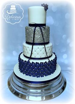 navy blossom wedding cake