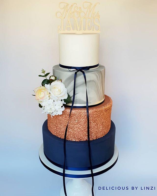 Navy and rose gold wedding cake