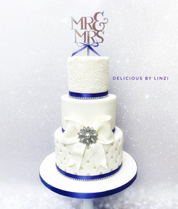 purple and white sparkle wedding cake