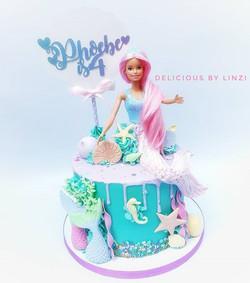 Barbie mermaid drip cake in muted pastel