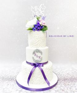 purple and white ruffle wedding cake