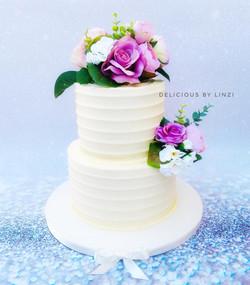 2 tiered rustic buttercream wedding cake