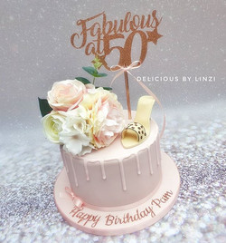 Pretty rose gold and blush drip cake wit