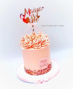 blush 1st birthday cake
