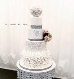 White ruffled wedding cake