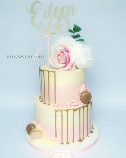 Pretty ivory and blush drip cake with to