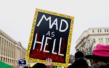 "Woman March protester in Washington, D.C. holds up a sign that reads ""Mad As Hell"""