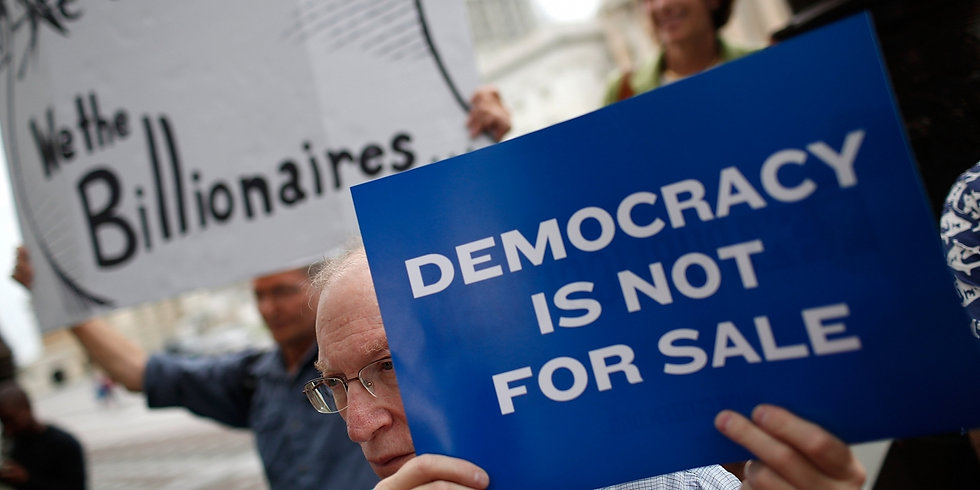 """Protestors hold up signs outside of the supreme court that says """"Democracy Is Not For Sale"""""""