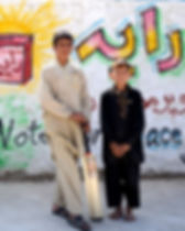 We lobby Congress to pomote peace and diplomacy while two young boys stand in front of a wall
