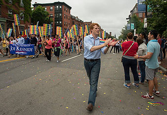Representative Joe Kennedy attends a pride parade in his district and with his constituents