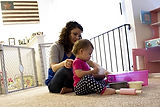 A female veteran plays with her daughter at home. She has struggle since returning home from the Iraq War.