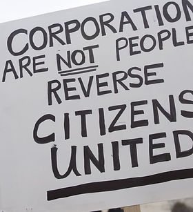 Sign at a protest outside the Capitol Building that says, Corporations Are Not People