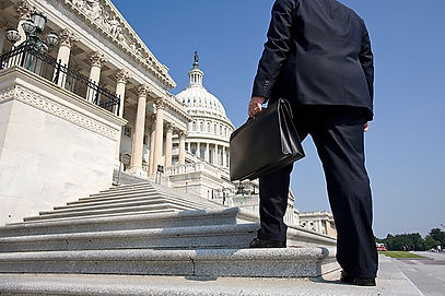 A lobbyist is on his way to a meeting in the US Capitol Building with his briefcase