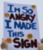 A woman holds up a sign saying she is angry, but all she can do is make a sign. Instead of protesting or maching, people can use our crowdfunding platform to start lobbying campaigns and actually have real influence over Congress and pass important pieces of legislation on behalf of the people
