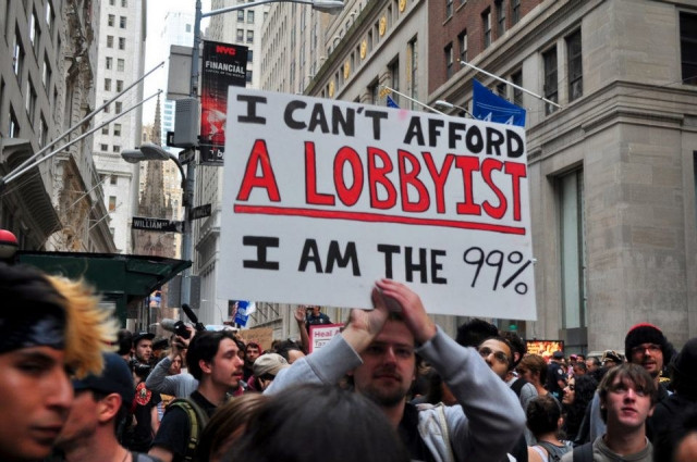 A protester in the Occupy Wallstreet movement wants to hire a lobbyist to bring about political change but he can not afford one because he is the 99%
