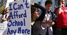 "Student protestors march about student debt and hold up a sign that says, ""I can't afford school anymore"""