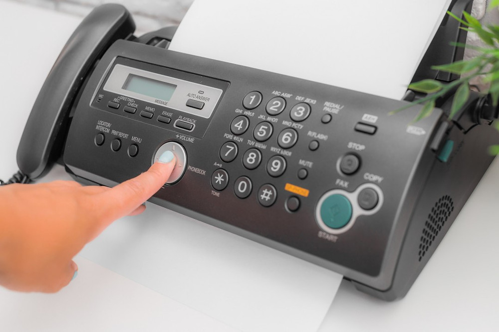 A person sends a fax to their member of Congress