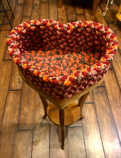 Heart Braided Basket atop a Wooden Heart Stand