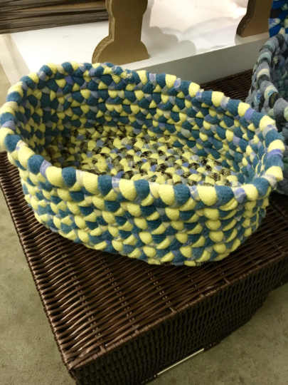 Blue and yellow oval braided basket