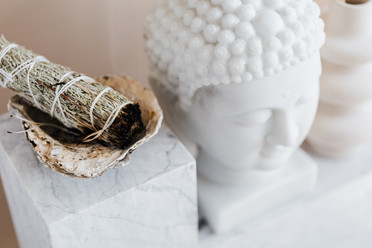 sage-smudge-stick-in-bowl-on-marble-shel
