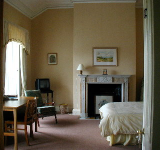 Jura (Double Room) - This is one of a number of en-suite rooms which overlooks the sea. Note the beautiful fireplace - one of many original features of the house. light airy feel with views of the grounds
