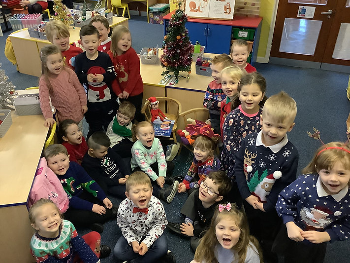 P1A wearing Christmas Jumpers in school to raise money for Charity.