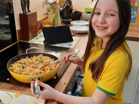 Evie Ferrier P6 learning to cook!