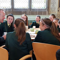 Students having tea and chatting to Archbishop Eamon. The students had been attending Mass and were delighted to be invited for Tea with Archbishop Eamon.