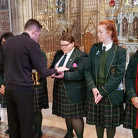 Fr. Thomas blessing the hands of our Year 13 Eucharistic Minister Team.
